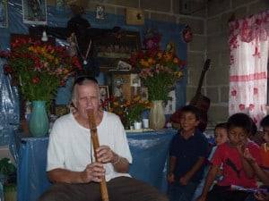 Playing his flute for the kids
