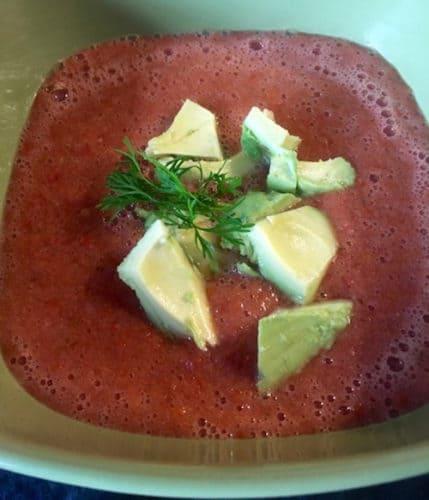 Gazpacho garnished with avocado and cilantro