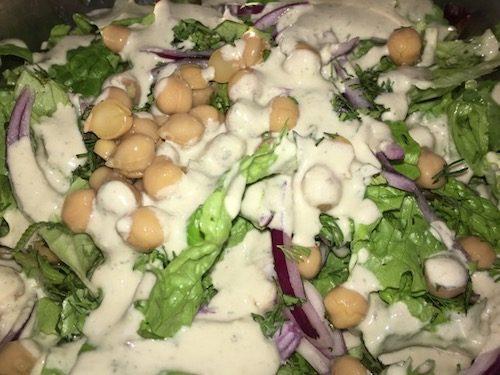Salad with creamy roasted garlic dressing (vegan)