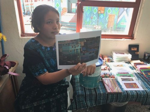 Learning about the Pintando Santa Catarina project in the office on the central square