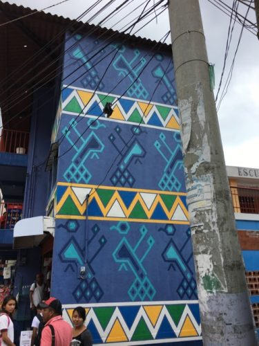 Painted buildings based on designs from the weavings of Santa Catarina Palopó