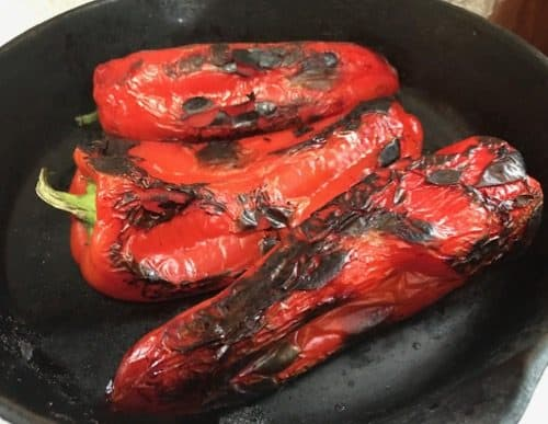 Red peppers roasted in a cast iron pan