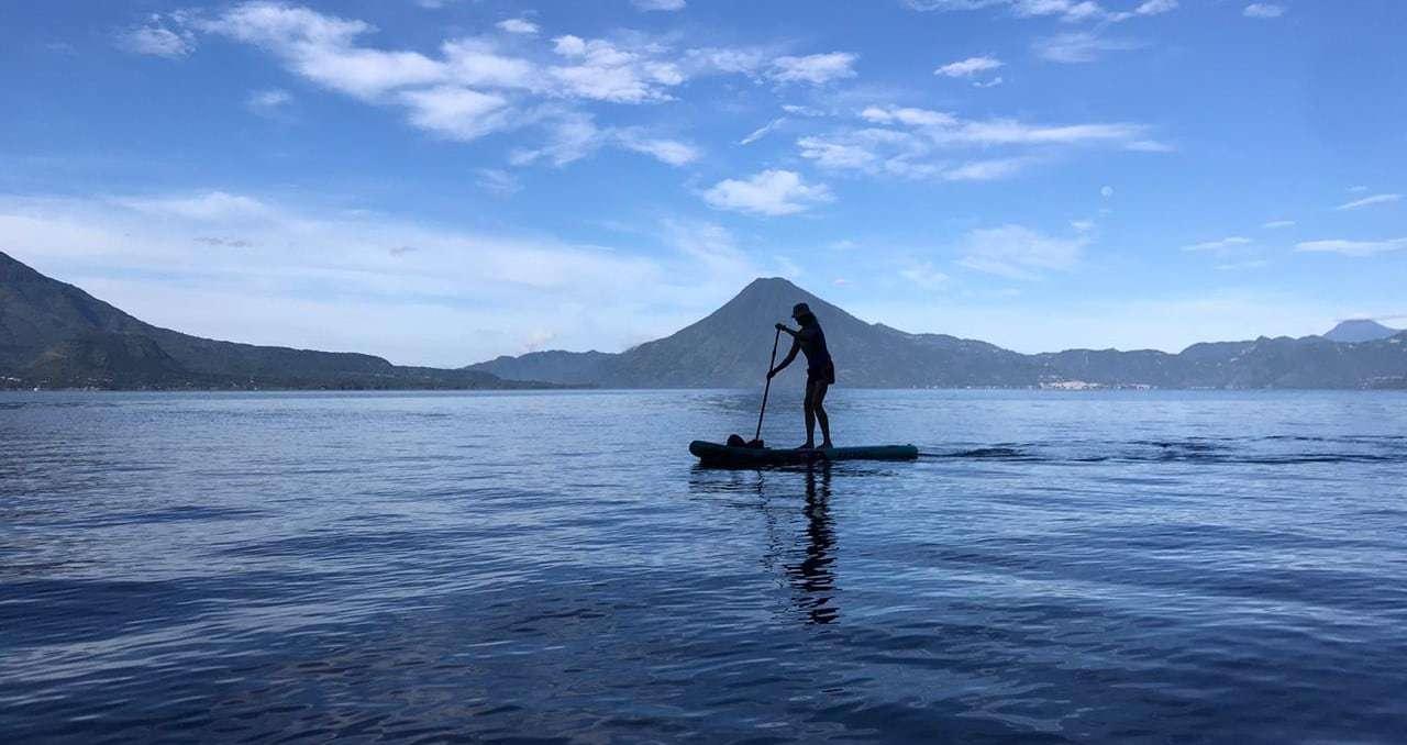 Photo of Traci paddleboarding on Lake Atitlan