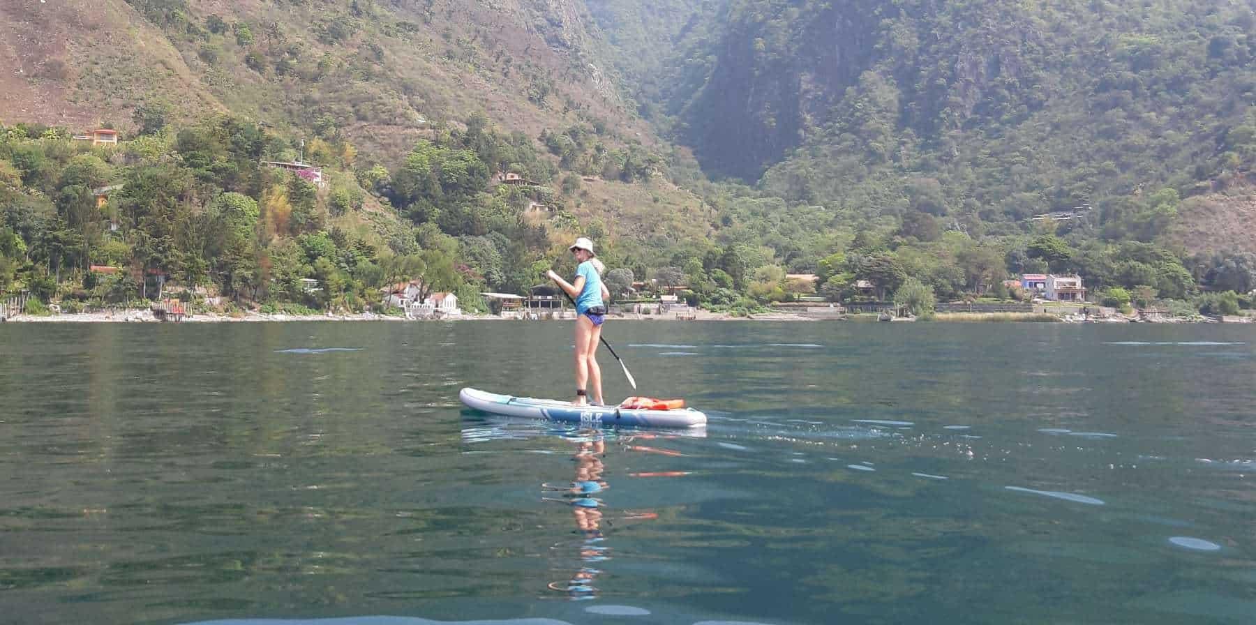 Traci paddleboarding for the first time in Santa Cruz La Laguna