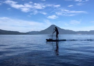 Photo of Traci paddleboarding on Lake Atitlan