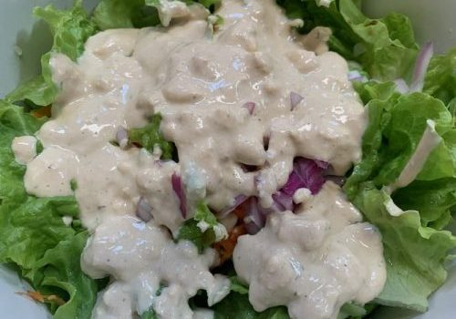 Photo of vegan blue cheese dressing on salad